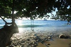Surf on a sandy beach Stock Photo