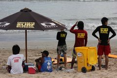 Surf school staff on Kuta Beach Stock Photo