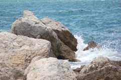 Fancy a swim??. Surf and Sea round Europa Point, Gibraltar seen from the sea royalty free stock photo
