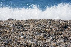 Surf on the sea. small pebbles on the shore. royalty free stock photo