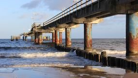 Baltic Seacoast With Long Bridge And Wooden Wave Breaker stock photography