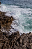 Surf sea waves motion on rock Stock Images