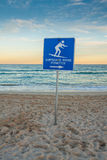 Sunset beach with surf sign. Stock Photo