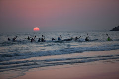 Surf-Ski Paddlers Sun Rising  Stock Image