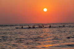 Surf-Ski Paddlers Training Sunrise Ocean Royalty Free Stock Images