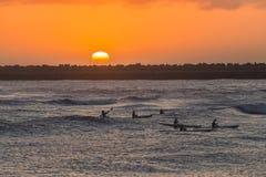 Surf-ski Paddlers Ocean Sunrise. Surf-ski paddlers at sunrise training on ocean waves waters around shallow reefs Stock Photography