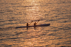 Surf-Ski Paddlers Ocean Sun Reflections  Royalty Free Stock Photo