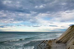 Surf spot with waves on atlantic ocean in colorful sky with clouds Royalty Free Stock Photography