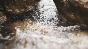 Surf between stones stock footage