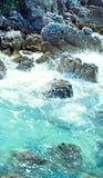 Surf on stones near island Royalty Free Stock Image