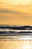 Surf at sunrise 2. Fraisthorpe beach at sunrise , low tide Royalty Free Stock Images