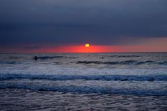 Surf at sunset. On the beach Royalty Free Stock Photography