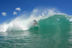 Surf tube ride. A surfer getting a nice barrel royalty free stock photography