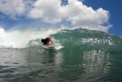 Surf tube ride. A shortboarder getting a tube ride in hawaii's clear water Stock Image