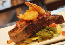Surf and Turf. Steak with tempura prawn and asparagas Stock Images