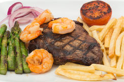 Surf and turf beef steak dinner Royalty Free Stock Photo
