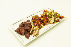 Surf and turf, fried lobster and juicy stake with a garnish from fried vegetables. Stock Images