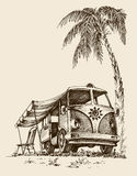Surf van on the beach. Under the palm tree, chair and parasol Stock Photo