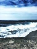 Surf on the volcano coast Stock Photos