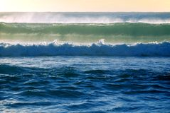 Surf wave breaks in the ocean. Barrel ocean wave about to break in the early morning surf on the Gold Coast Queensland Australia Stock Photography