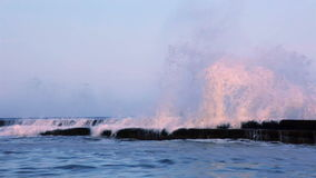 Surf Wave on the Breakwater at Sunset. Slow Motion stock video footage