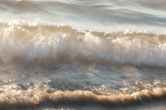 Surf wave. Rapid shot with sunshine sparks in surf wave. made on long shutter speed Royalty Free Stock Photos