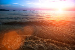 Surf waves on the ocean side during the amazing sunset. Nature. Royalty Free Stock Photography
