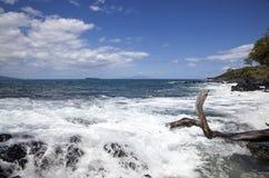 Surf, Waves, Rocks. Surf crashing on rocks along the shore on Maui, Hawaii stock photo