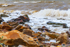 Surf waves stones Royalty Free Stock Photos