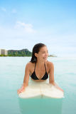 Surf woman surfing on surfboard in Waikiki, Hawaii Royalty Free Stock Photo
