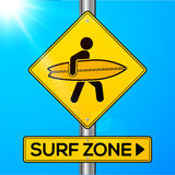 Surf zone yellow road sign on sky background Stock Photo