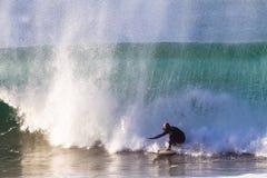 Surfa Rider Escape Danger arkivbild