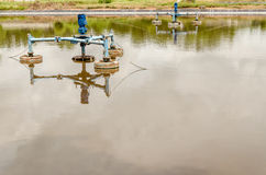 Surface aerators in waste water pond at landfill site Stock Images