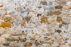 Surface of ancient wall of natural stone royalty free stock photography