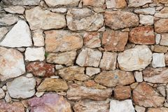 Surface of ancient wall of natural stone stock photography