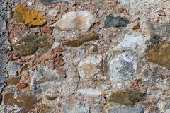 Surface of ancient wall of natural stone royalty free stock image