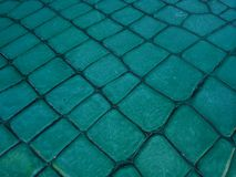 Surface with aquamarine colored stone blocks for indoor and outdoor decoration, background and texture. Surface  colored stone blocks indoor outdoor decoration stock images