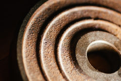 Surface of barbell disc on a black backgrounds Royalty Free Stock Image