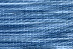 Surface bleue de tapis de paille de couleur Photographie stock