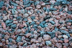 The surface of the blue and red building gravel. The texture of the blue and red building gravel stock photography