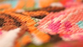 Surface of bright embroidery with flowers, close stock video