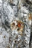 Surface of broken Mineral with red Sprinklings Royalty Free Stock Photos