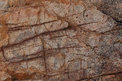 Surface of the brown stone. With deep cracks Stock Photo