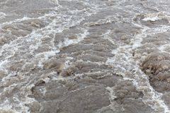 Surface of bubbling brown and dirty water. Stock Images