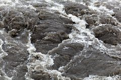 Surface of bubbling brown and dirty water. Royalty Free Stock Photography