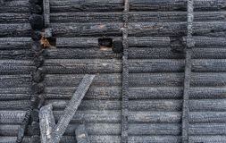 The surface of the burnt wall of a wooden log house.  stock photo