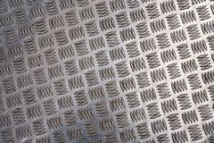 Surface of a checker plate Royalty Free Stock Images