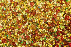 Surface coated with colorful sequins royalty free stock image