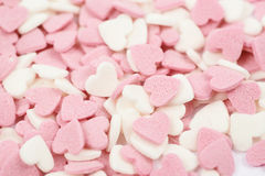 Surface coated with heart shaped sprinkles Stock Image
