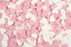 Surface coated with heart shaped sprinkles Royalty Free Stock Image